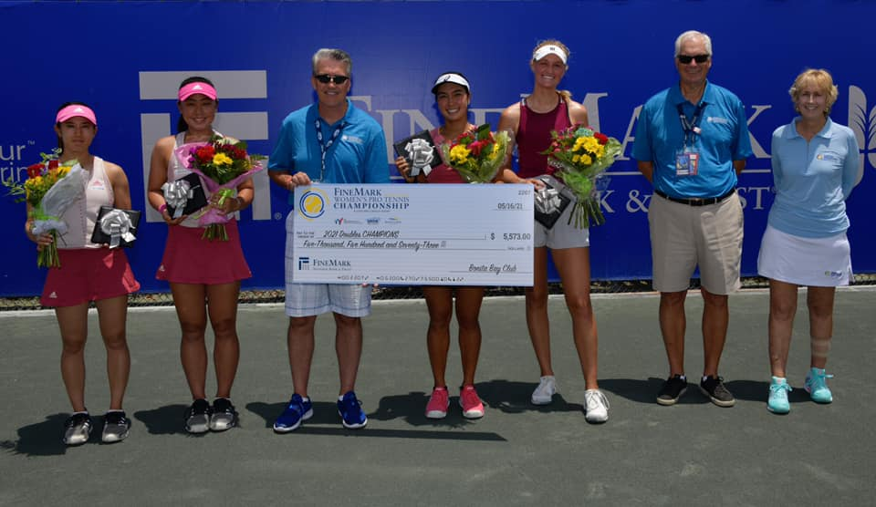 Harlan Parrish presenting check to double tennis winners