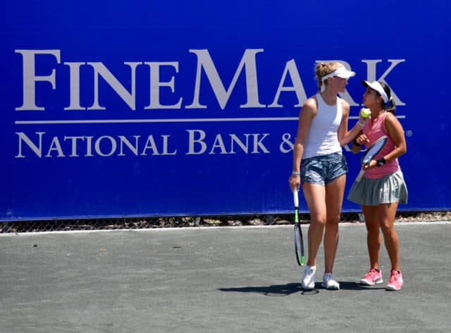 Two female tennis players talking