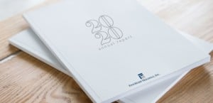2020 annual report white books on wooden table